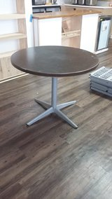 Round table with metal stand in Sugar Land, Texas