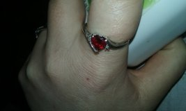 Sliver Garnett heart birthstone with cubic on each side of the heart in Fort Drum, New York