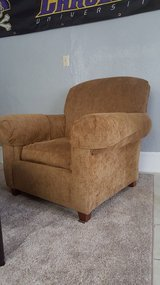 Brown cloth armchair in Greenville, North Carolina