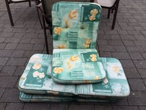 Green outdoor chair cushions in Ramstein, Germany