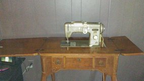 Antique Sewing Machine in Cabinet in Houston, Texas