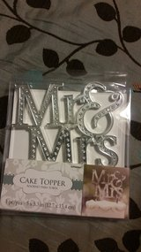 Mr & Mrs cake topper with candle in Kingwood, Texas