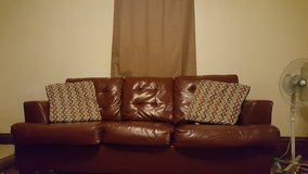 Matching leather love seat and couch in Fort Wayne, Indiana