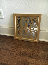 Gold mirror wall hanging in Denton, Texas