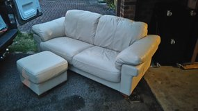 2 seater cream leather sofa and foot stall in Lakenheath, UK