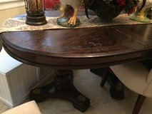 Solid wood dining table in Baytown, Texas