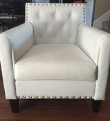 White tufted chair in Fort Campbell, Kentucky