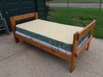 Wood twin bed in Fort Riley, Kansas