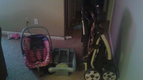 Cosco car seat w / base and Eddie Bauer stroller in Fort Wayne, Indiana