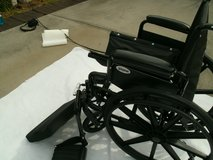 wheel chair, new with leg/foot attachments in Beaufort, South Carolina