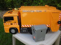 Dicke Garbage Truck with garbage dumpster in Spangdahlem, Germany