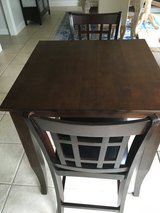 Espresso color counter height table and 2 chairs in Huntsville, Alabama