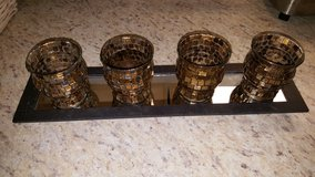 Mirrored shelf with 4 candle holders in Fort Drum, New York