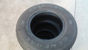"""Set of 4 tires """"grabber"""" with the rims for a chevy in Chicago, Illinois"""