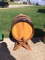 Large wine barrel with wood stand in Fort Leonard Wood, Missouri