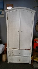 Wicker white armoire in Kingwood, Texas