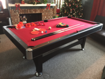 Combination pool table, ping pong table and electronic air hockey table in Jacksonville, Florida