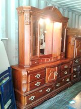 Stately solid wood carved dresser w/ mirrored hutch top and curio sides in Camp Lejeune, North Carolina