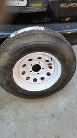 Brand new Tire and wheel for small trailer. F78-14 LRC. $50 obo in Fort Riley, Kansas