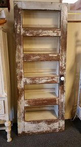 Custom shelf made from antique door in Kingwood, Texas