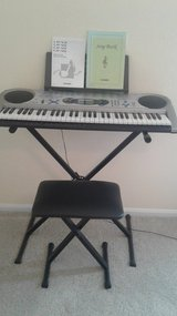 Casio keyboard and adjustable bench in Conroe, Texas