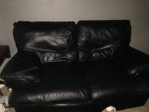 Black leather couch in Conroe, Texas