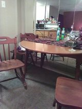 Old Amber drop leaf table with 3 matching chairs and 1 odd. in Longview, Texas