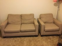 Beige love seat and chair in Fort Polk, Louisiana