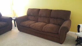 Chocolate couch and loveseat in Fort Bliss, Texas