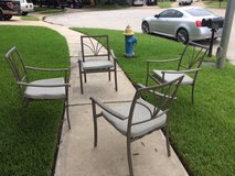 Set of 4 like new patio/deck chairs with brand new cushions in Katy, Texas
