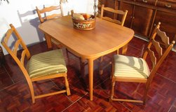 Light Colored Solid Wood Tablewith 4 Light Green Chairs in Ramstein, Germany