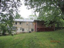 House for rent ready to move in (no pets) deck with roof,  car garage & extra carport! in Fort Campbell, Kentucky