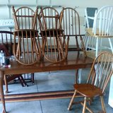 Wooden table with leaf and six chairs. in Beaufort, South Carolina