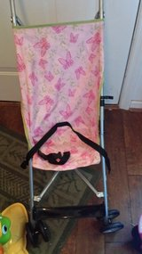 Pink foldable stroller and high chair in Columbus, Georgia
