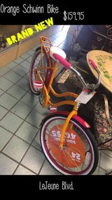BRAND NEW ORANGE SCHWINN BIKE in Camp Lejeune, North Carolina