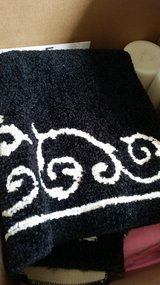 Black & white area rug in Oswego, Illinois