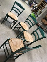 Rattan seat dining chairs. Set of four $80. Easy to repaint the color of your choice.  Wood. in Schaumburg, Illinois