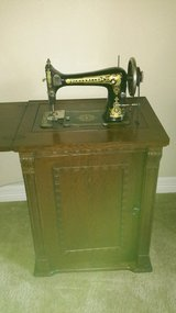 Rare Antique Franklin treadle  sewing Machine in  parlor wood cabinet in CyFair, Texas