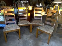Matching oak dining room chairs in Kankakee, Illinois