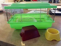 Hamster cage with food/water dish and small house in Watertown, New York
