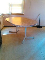 Table with leaf can be round or large. in Quad Cities, Iowa