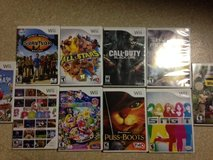 10 Wii Games (Call of Duty, Mario Party 9, Survivor, National Geographic) in Okinawa, Japan