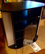 BLACK ENTERTAINMENT CENTER WITH GLASS DOOR in Naperville, Illinois