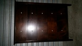 Tall dresser 100 % wood chocolate color in Fort Bliss, Texas