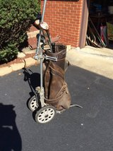 Golf cart, bag, clubs, and umbrella in Glendale Heights, Illinois