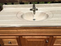 Oak Vanity with Single Marble Sink Top and Mirrored Med Cabinet. in Fort Belvoir, Virginia