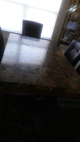 Marble dining room table and 6 chairs in Fort Bliss, Texas