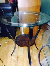 Matching glass top coffee table and end table in Wilmington, North Carolina