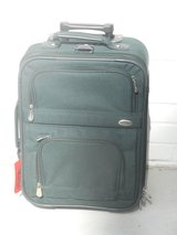 Hand-carry suitcase with two zippered pockets, on wheels. in Eglin AFB, Florida