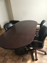 Executive conference table with 6 leather rolling chairs in Colorado Springs, Colorado